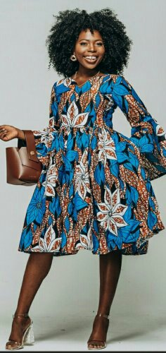 Woman in blue and brown african print dress