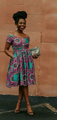Woman in multicolored african print dress