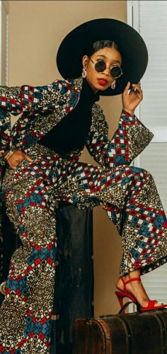 Woman in African print jacket and wide leg pant