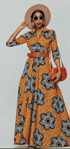 Woman in african print maxi dress with a collar and red waist belt
