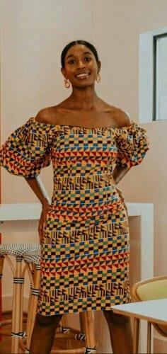 Woman in kente african print dress