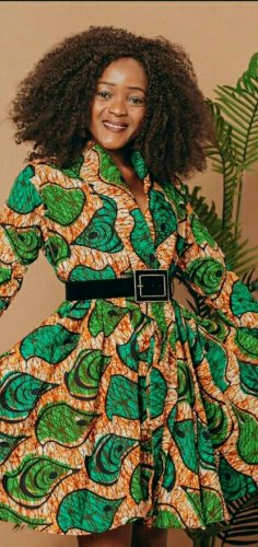 Woman in Flared brown and green patterned african print dress