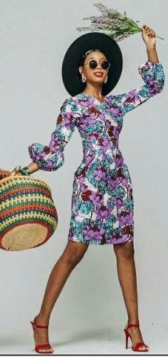Woman in knee-length africanot print dress