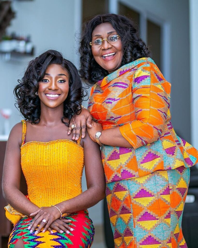 Mom and daughter in kente patterns